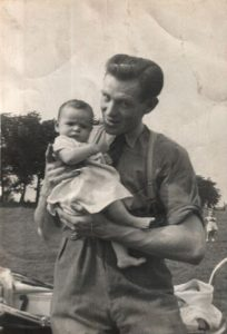 Photo of Wendy MacIntyre as a baby with her father in Glasgow